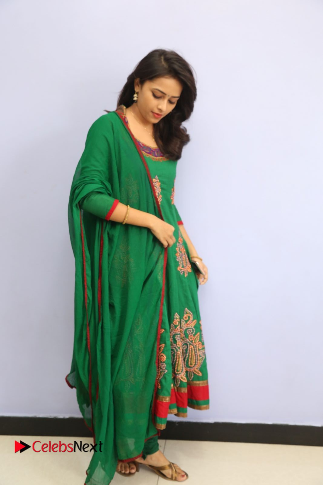 Actress Sri Divya Pictures in Green Salwar Kameez at Rayudu Team Meet  0072.JPG