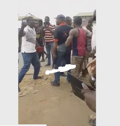 Man Strips Naked To Fight SARS Official in Benin (photos)