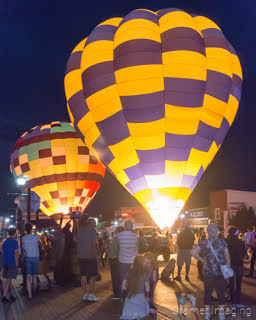 Cramer Imaging's fine art photograph of a hot air balloon glow featuring 2 balloons at night in the streets of Panguitch Utah
