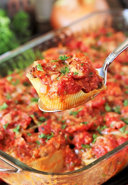 Serving Spoon with Ground Beef Stuffed Shells Image