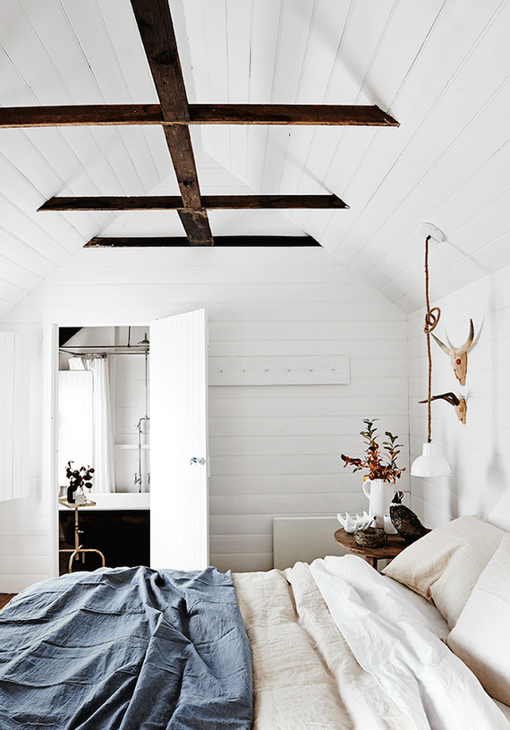 Bedroom with exposed roof beams | The Estate Trentham
