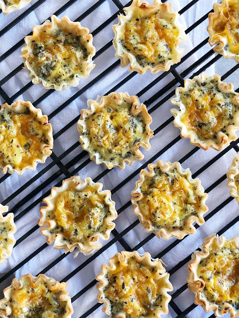 mini phyllo shells filled with cheese and egg quiche