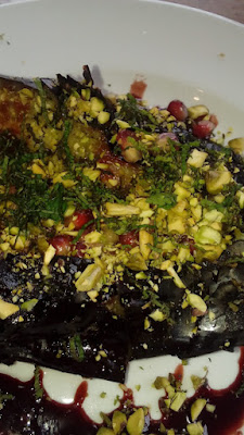 Burnt Aubergine date molasses, pistachio nuts, mint and pomegranate seeds