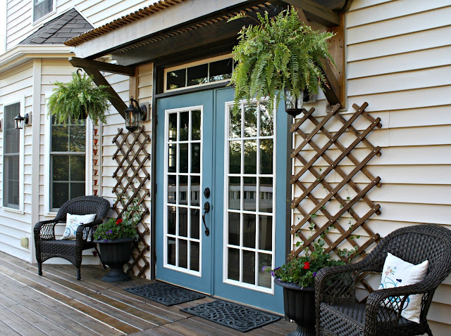 Back door makeover with paint, trellis and new hardware