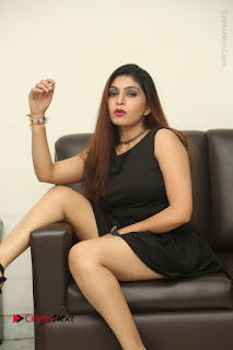 Tollywood Upcoming Actress Pooja Roshan Stills in Black Short Dress at Plus 1 Movie Trailer Launch  0260.JPG