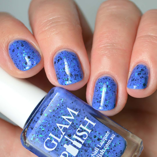 blue nail polish with color shifting flakies four finger swatch