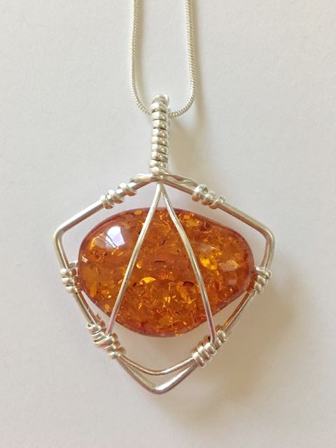 Easy caged wire wrapped pendant tutorial the beading gems journal her faux amber caged wire wrapped pendant tutorial can be used with many drilled gemstone nuggets i like how she wire wraps her bead sideways mozeypictures Image collections