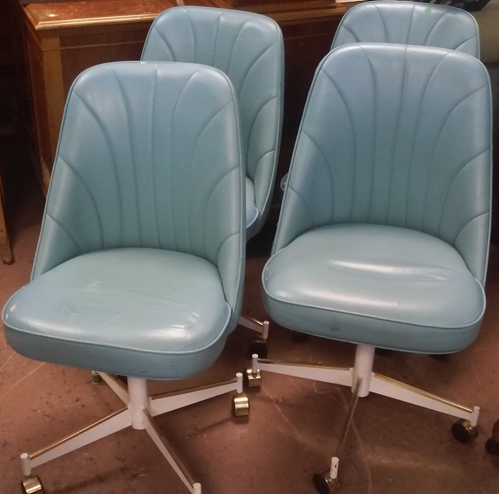 SOLD **REDUCED** Vintage Vinyl Chairs On Wheels   $30 / Set Of 4