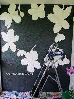 How I Hand painted flower wall on condo lanai wall