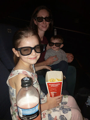Baby Milestones At 11 Months Old - Image Shows Family Wearing 3D Glasses In Cinema
