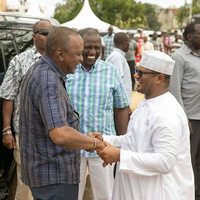 Omar Hassan with President Uhuru Kenyatta. PHOTO | FILE