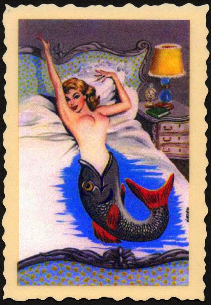 vintage mermaid resting in mermaid bedroom