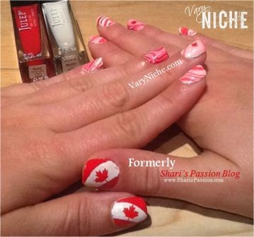 Two hands with red and white nail art designs.