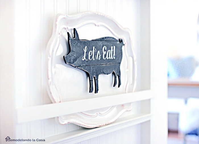 how to build a plate rack with big platters on display and wooden pig with let's eat sign