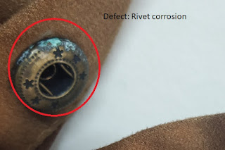 Defective trim attached in a garment