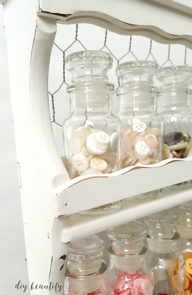 A vintage spice rack makes a beautiful and functional way to store small craft supplies like buttons! See how I transformed this vintage spice rack at