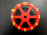 Glue the numbers of the Clock Wheel frame