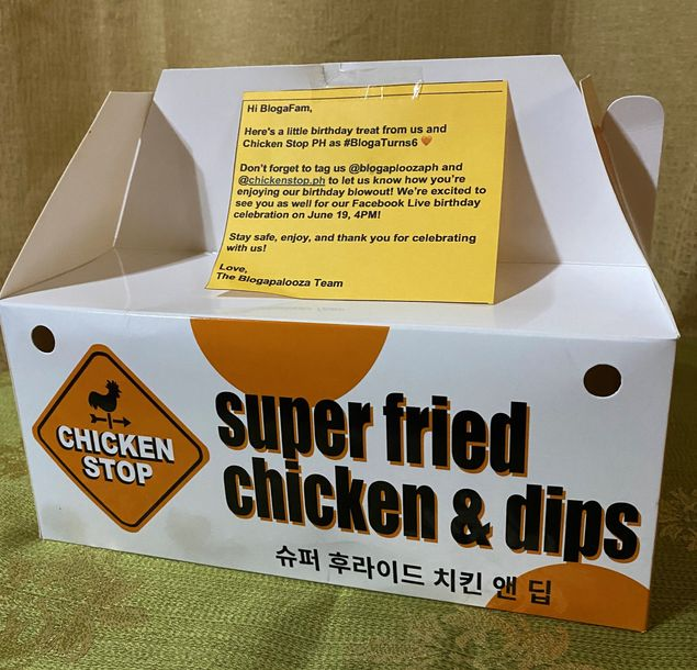A box of Chicken Stop fried chicken and dips