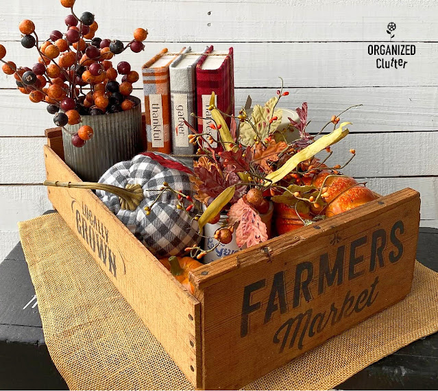 Photo of stenciled fruit crate filled with fun fall decor.
