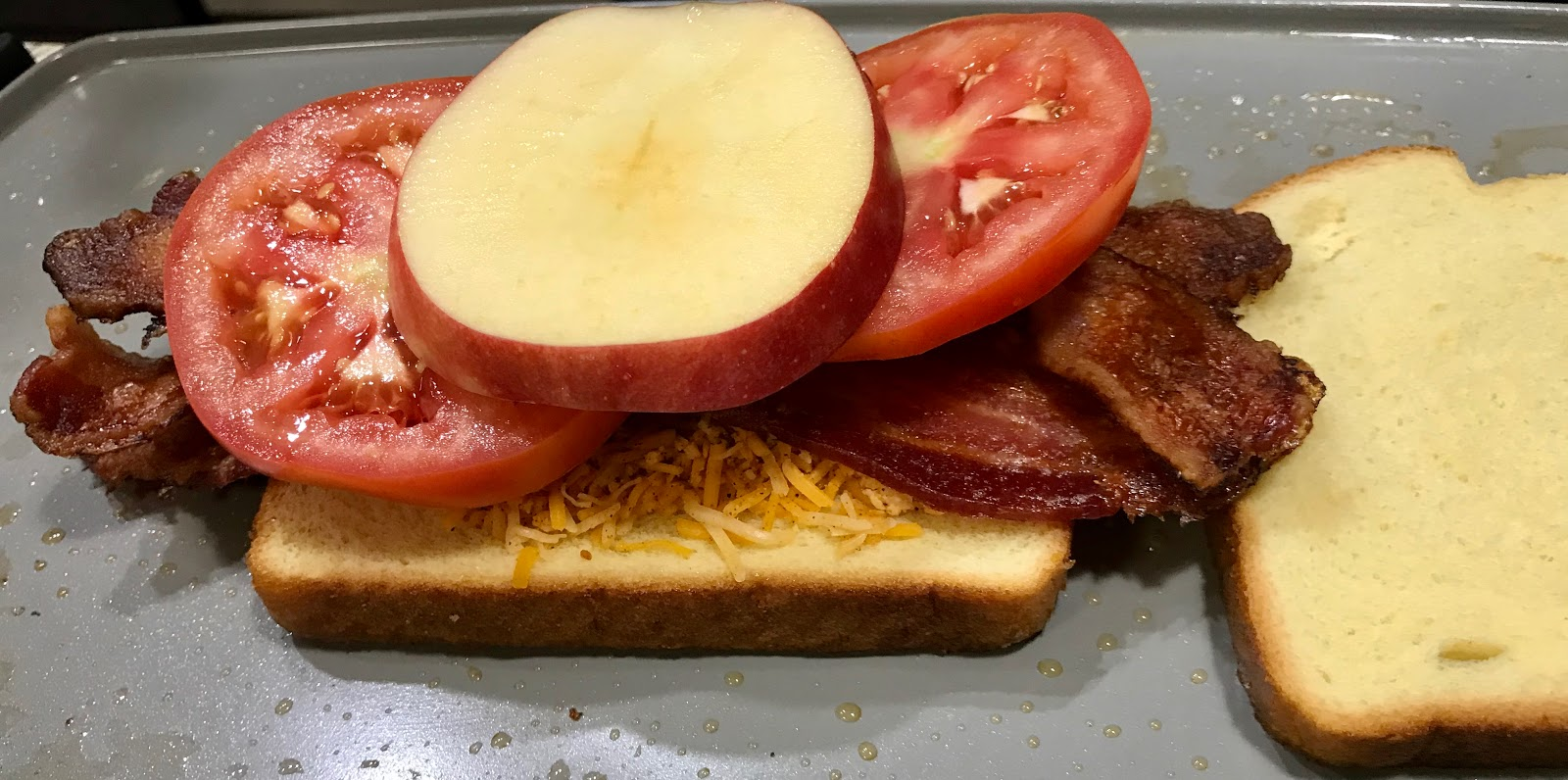 Cheese sandwich piles with bacon, tomato and apples