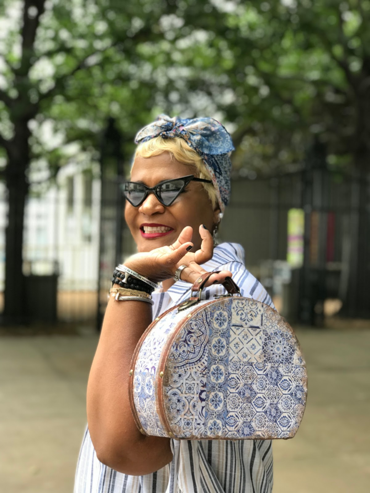 Image: Tangie Bell is showing her handbag, glasses and outfit. Seen first on Bits and Babbles Blog