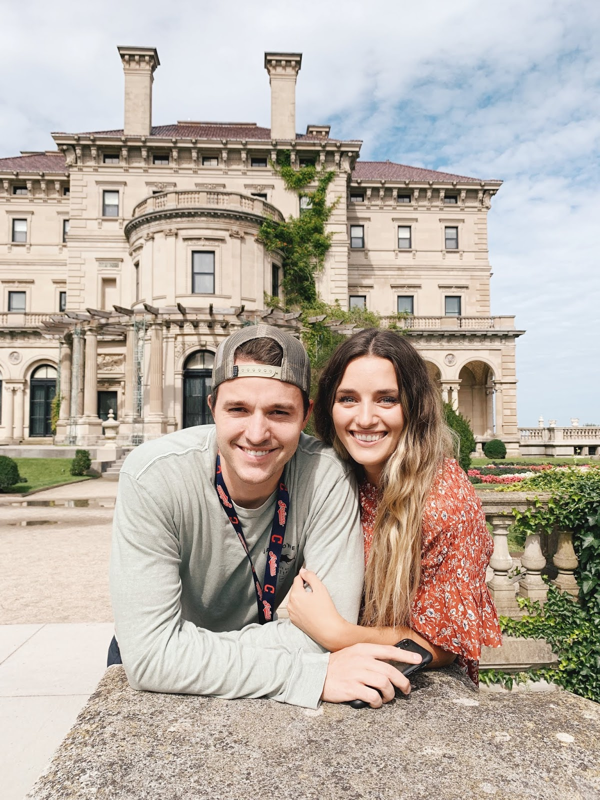 Couple smiling in front of Newport, RI mansions