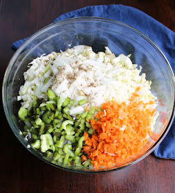 big bowl of shredded cabbage, onions, peppers, carrots and celery seed for coleslaw
