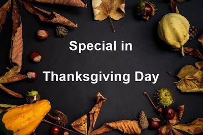 Image from the top with dry leaves on black background written Thanksgiving Day on it