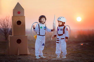 Children pretend to be astronauts