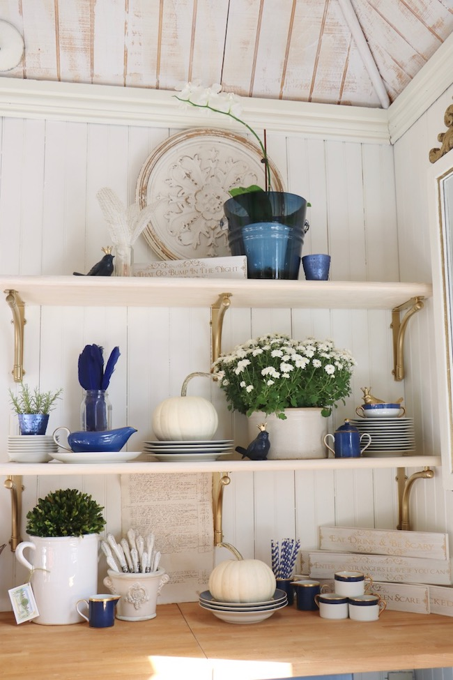Midnight blue dishes with gold rims for fall decor go with beautiful everyday blues in the garden shed