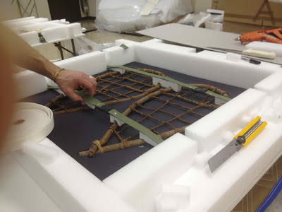 art conservation, storage packing and shipping of artifacts for exhibit and transport of collecition