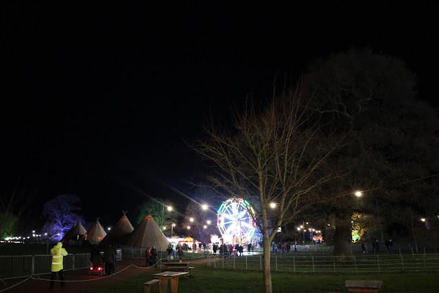 View from the entrance looking down on Westonbirt Enchanted Christmas, including the very colourful big wheel.