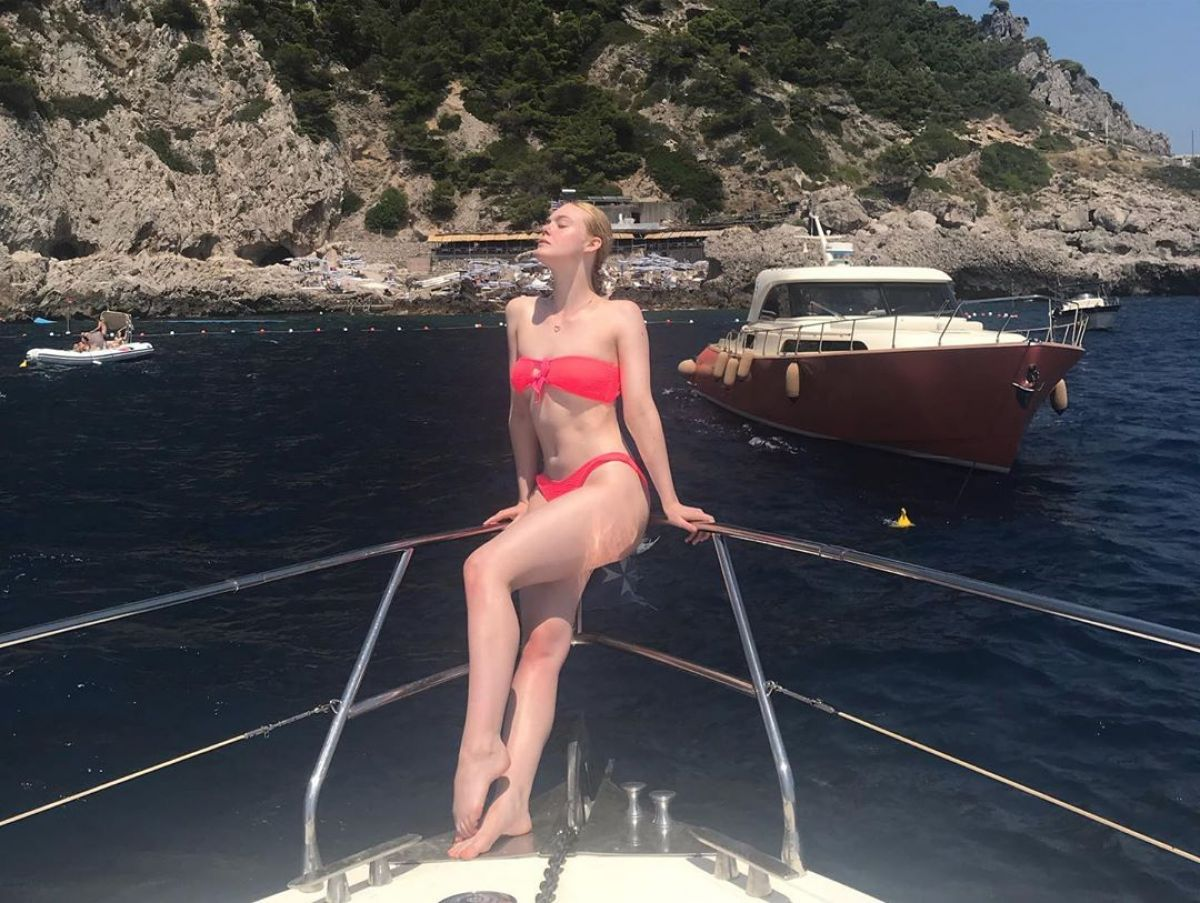 Elle Fanning sizzles as she puts curves on show in hot pink bikini