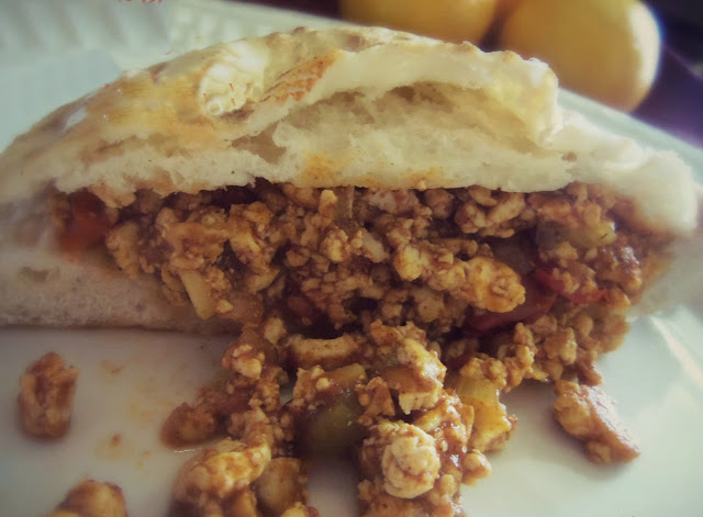 meatless sloppy joe in a pita pocket on a plate
