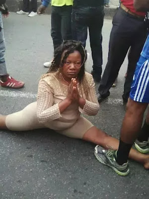 Woman in Douala Cameroun goes mad on streets