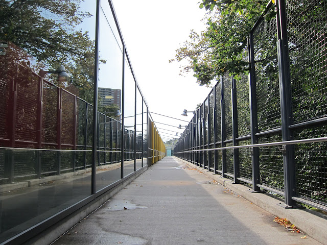 Pedestrian walkway along the north side of Victoria Park station
