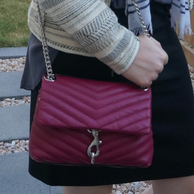 Rebecca Minkoff Edie small crossbody bag in magenta with black and grey work outfit | away from the blue
