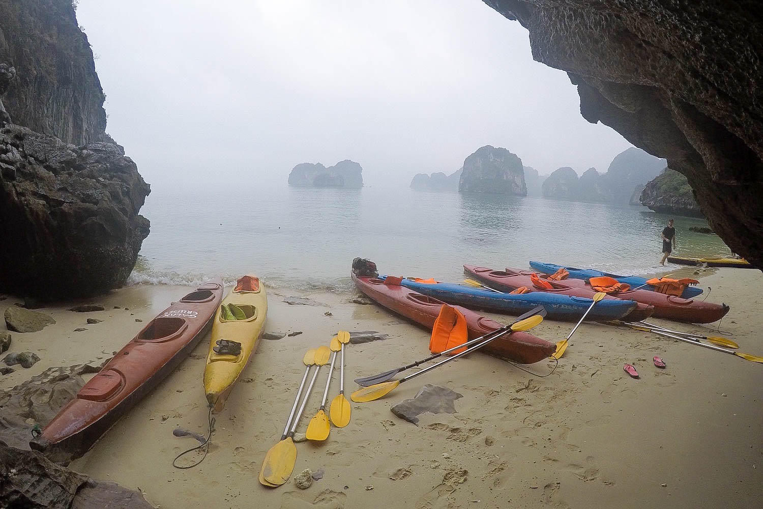 halong bay beach and canoes