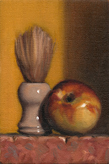 Still life oil painting of a nectarine beside a shaving brush.