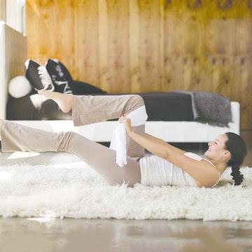 Single leg stretch with a Towel