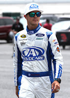 Trevor Bayne, driver of the #6 AdvoCare Ford, walks through the garage area during practice for the NASCAR Sprint Cup Series GEICO 500 at Talladega Superspeedway on April 29, 2016 in Talladega, Alabama. (Jerry Markland/Getty Images North America)