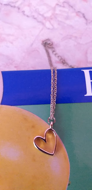 gold necklace and heart pendant