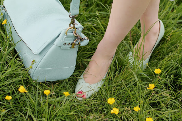 Mint green vintage style shoes and camera bag