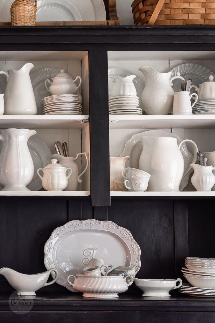 white ironstone collection in black hutch