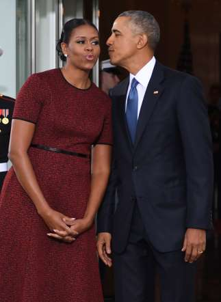 Photos: This Might Be the Most Powerful Red Dress Michelle Obama's Ever Worn