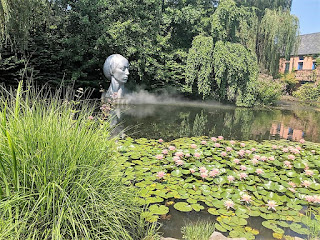 Sculpture of a Head in mist