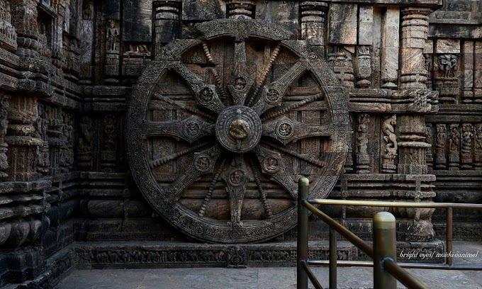 A stone wheel engraved in the walls of the Konark sun temple. Puri, Odisha, India