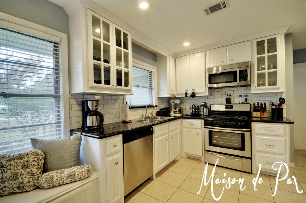 Black Kitchen Cabinets And Cream Floor Tiles