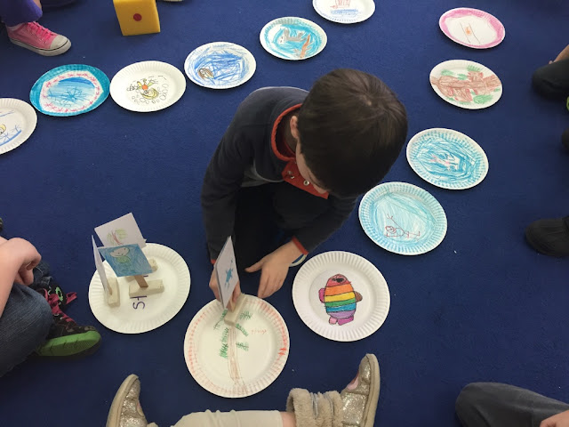 kindergarteners create a board game to apply learning about winter