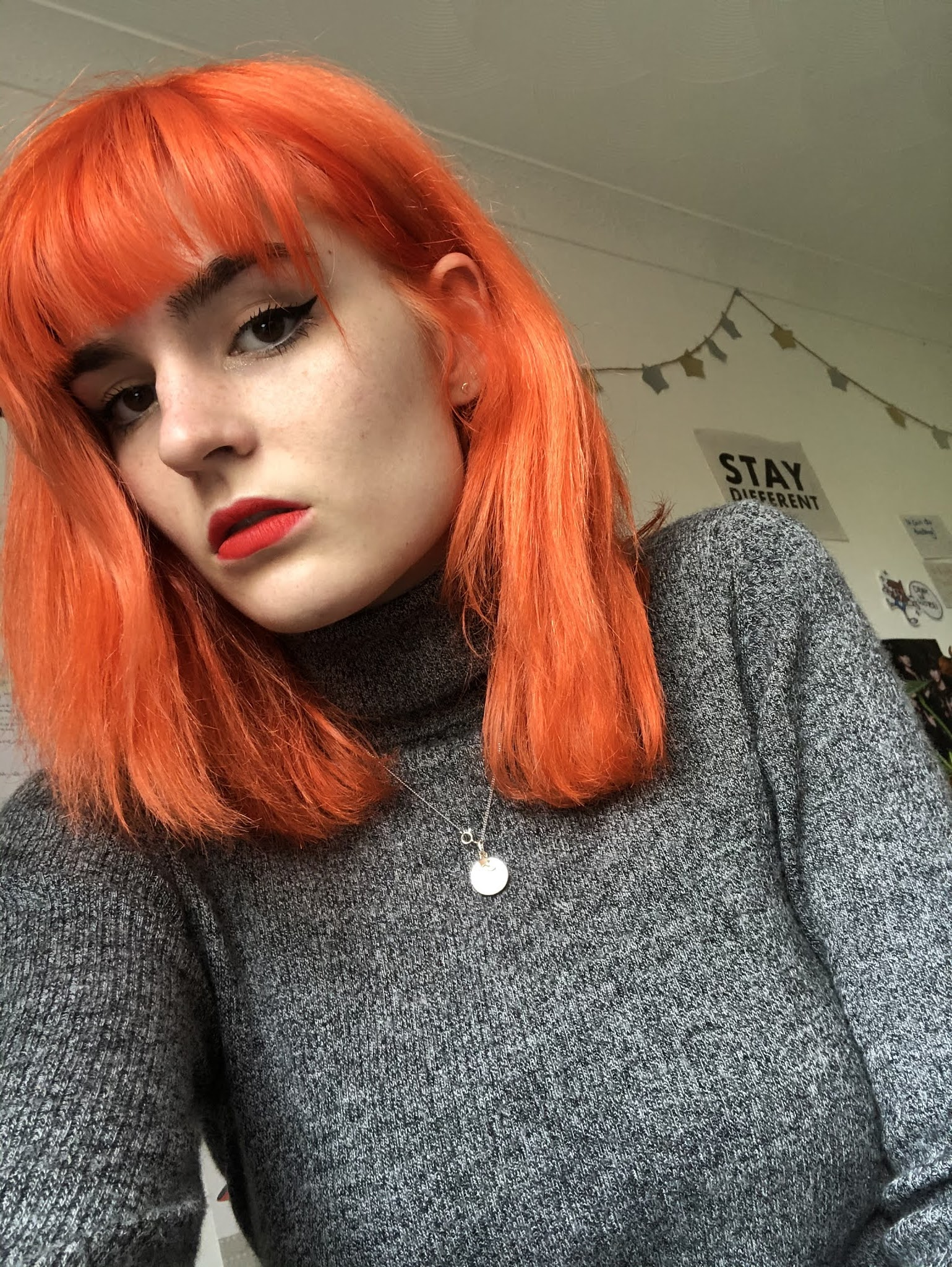 Girl with orange hair dyed with Directions Tangerine and grey turtleneck
